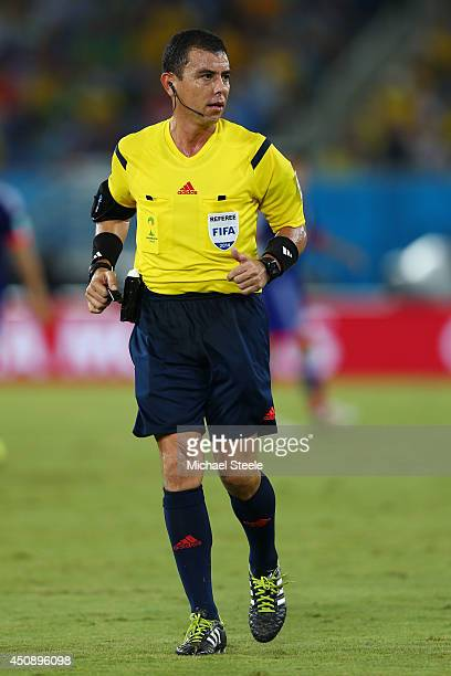 Referee Joel Aguilar looks on during the 2014 FIFA World Cup Brazil Group C match between Japan and Greece at Estadio das Dunas on June 19 2014 in...