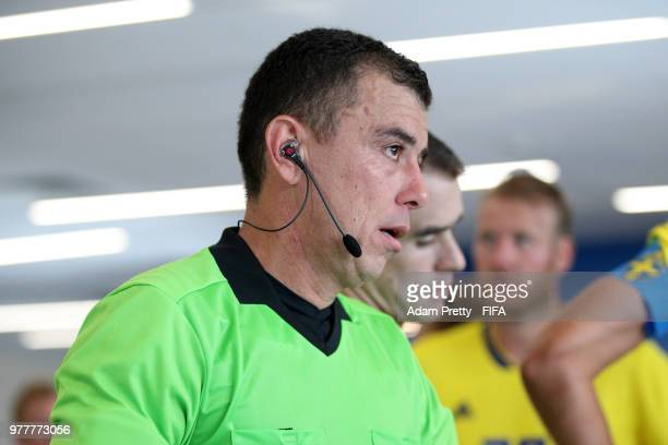 Referee Joel Aguilar looks on from the tunnel at half time during the 2018 FIFA World Cup Russia group F match between Sweden and Korea Republic at...