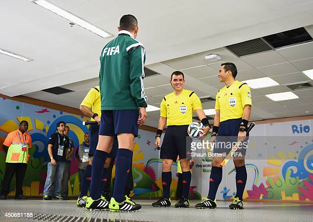 Referee Joel Aguilar prepares for the match with assistant referees during the 2014 FIFA World Cup Brazil Group F match between Argentina and...