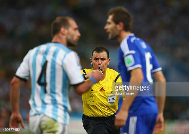 Referee Joel Aguilar reacts as Pablo Zabaleta of Argentina and Senad Lulic of Bosnia and Herzegovina clash during the 2014 FIFA World Cup Brazil...