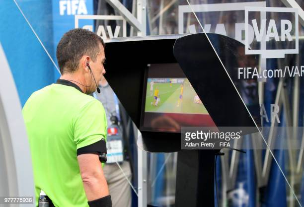 Referee Joel Aguilar reviews the VAR footage before awarding Sweden a penalty during the 2018 FIFA World Cup Russia group F match between Sweden and...