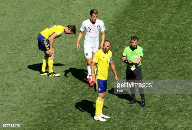 Referee Joel Aguilar shows a yellow card to Kim ShinWook of Korea Republic during the 2018 FIFA World Cup Russia group F match between Sweden and...
