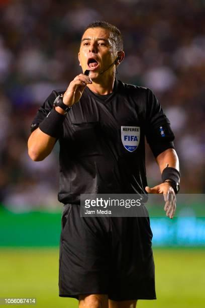 Referee Joel Antonio Aguilar of El Salvador gestures during the international friendly match between Mexico and Chile at La Corregidora Stadium on...