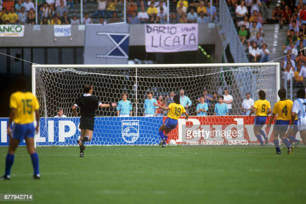 Referee Joel Quiniou points to the centre spot after Claudio Caniggia had scored the only goal of the game in the 81st minute Pictured for Brazil are...