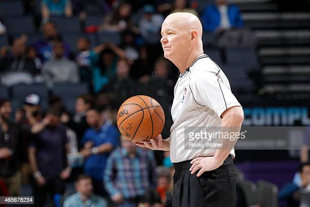 NBA referee Joey Crawford officiates the game between the Toronto Raptors and Charlotte Hornets on March 6 2015 at Time Warner Cable Arena in...