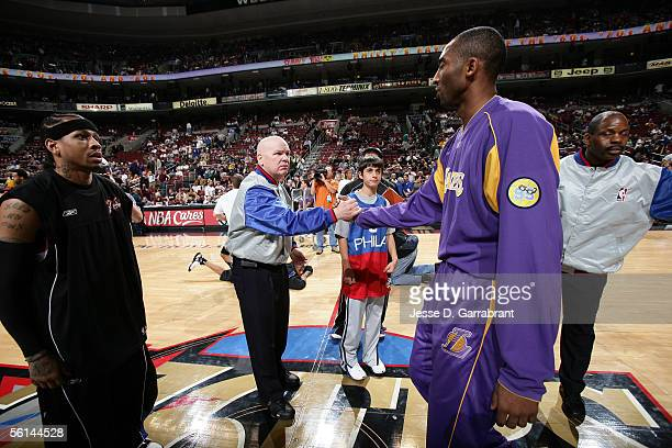 Referee Joey Crawford shakes hands with Kobe Bryant of the Los Angeles Lakers as Allen Iverson of the Philadelphia 76ers looks on before Crawford...