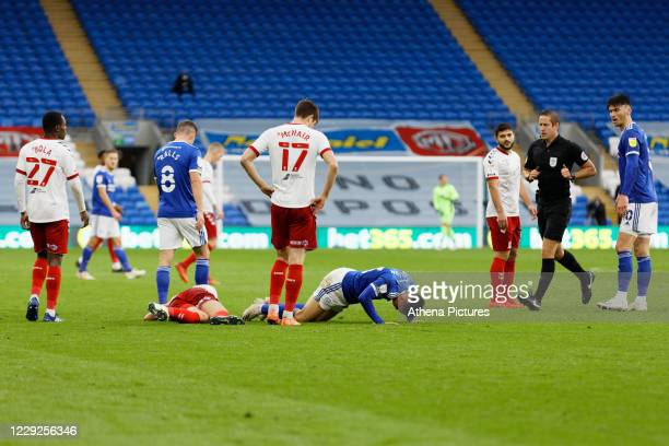 Referee John Brooks runs towards Dael Fry of Middlesbrough and Harry Wilson of Cardiff City who lie injured on the ground during the Sky Bet...