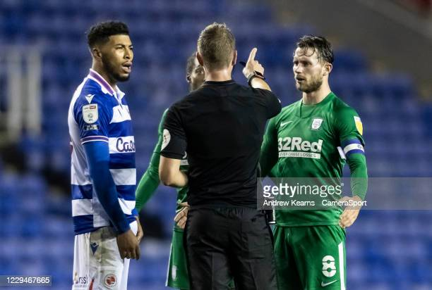 Referee John Brooks speaks to Preston North End's Alan Browne and Reading's Josh Laurent during the Sky Bet Championship match between Reading and...