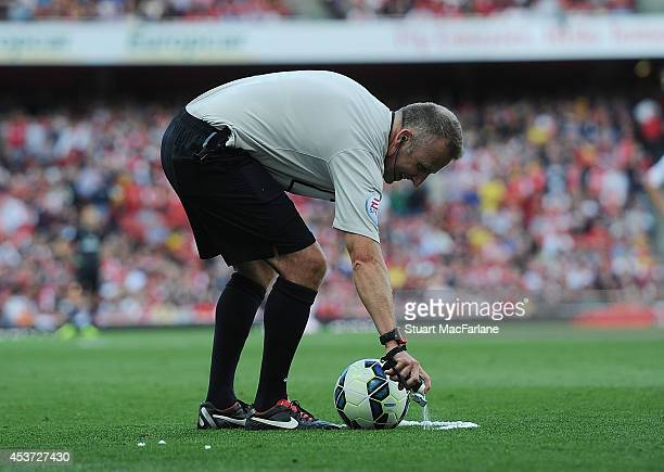 Referee John Moss uses vanishing spray during the Barclays Premier League match between Arsenal and Crystal Palace at Emirates Stadium on August 16,...