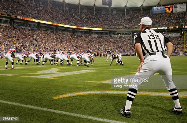 Referee John Parry oversees the action as the Minnesota Vikings defeated the Atlanta Falcons 243 at the Metrodome on September 9 2007 in Minneapolis...