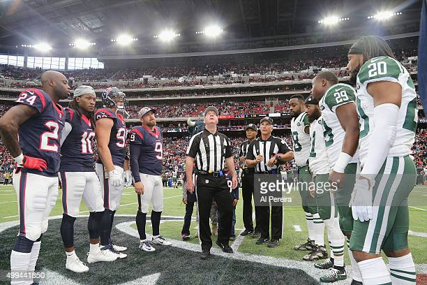 Referee John Parry performs the coin toss with captains of the Houston Texans and the New York Jets at Reliant Park on November 22 2015 in Houston...