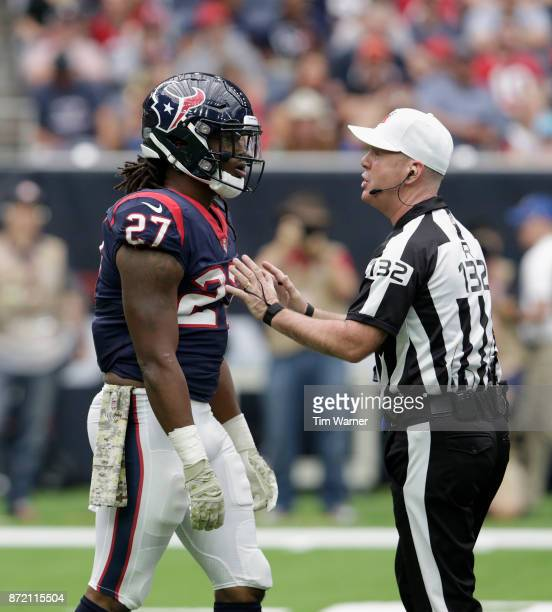 Referee John Parry reacts to D'Onta Foreman of the Houston Texans after a play in the first quarter against the Indianapolis Colts at NRG Stadium on...