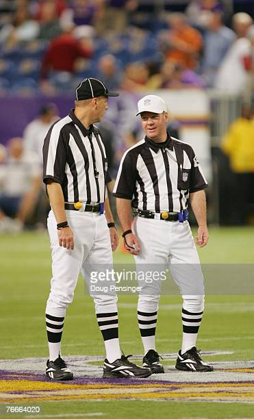 Referee John Parry right and Umpire Tony Michalek work the field as the Minnesota Vikings defeated the Atlanta Falcons 243 at the Metrodome on...
