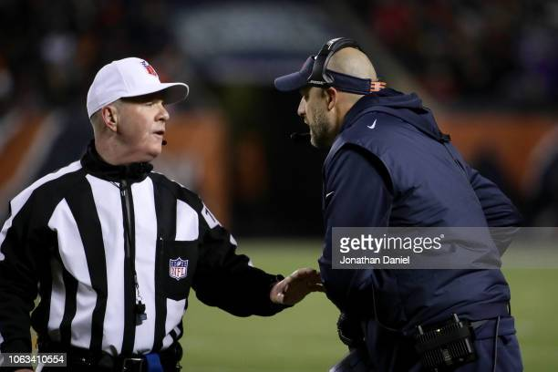 Referee John Parry talks with head coach Matt Nagy of the Chicago Bears in the third quarter against the Minnesota Vikings at Soldier Field on...