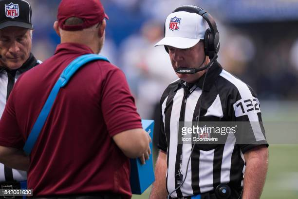 Referee John Parry watches a video replay on the new vision replay system during the NFL preseason game between the Cincinnati Bengals and...