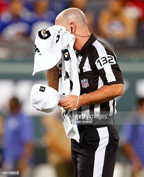 Referee John Parry wipes his face during an NFL preseason game between the New York Giants and the New York Jets at MetLife Stadium on August 22 2014...