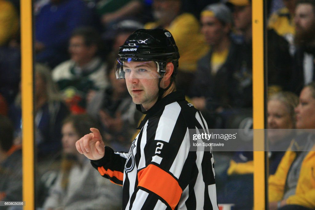 Referee Jon McIsaac (2) is shown during the NHL game between the Nashville Predators and the Minnesota Wild, held on April 1, 2017, at Bridgestone Arena in Nashville, Tennessee.