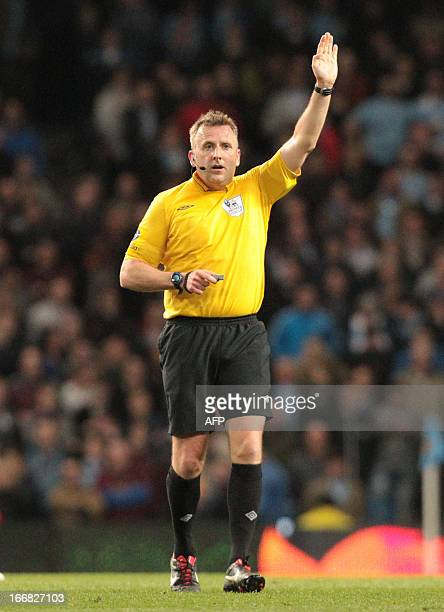 Referee Jon Moss awards a free kick during the English Premier League football match between Manchester City and Wigan Athletic at the Etihad Stadium...