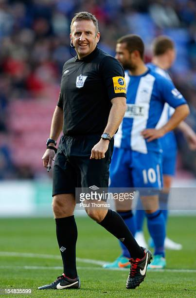 Referee Jon Moss during the Barclays Premier League match between Wigan Athletic and West Ham United at the DW Stadium on October 27 2012 in Wigan...