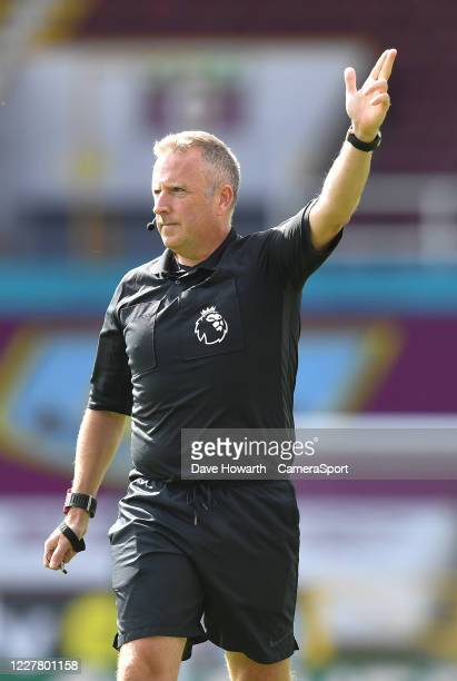 Referee Jon Moss during the Premier League match between Burnley FC and Brighton Hove Albion at Turf Moor on July 26 2020 in Burnley United Kingdom