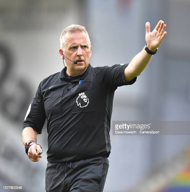 BURNLEY ENGLAND JULY Referee Jon Moss during the Premier League match between Burnley FC and Brighton Hove Albion at Turf Moor on July 26 2020 in...