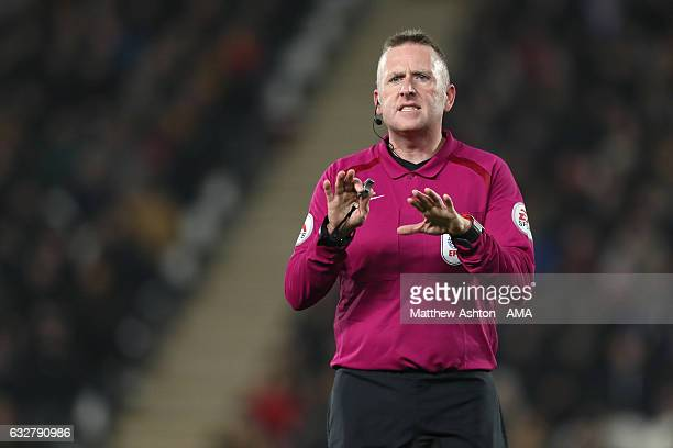 Referee Jon Moss gestures during the EFL Cup SemiFinal second leg match between Hull City and Manchester United at KCOM Stadium on January 26 2017 in...