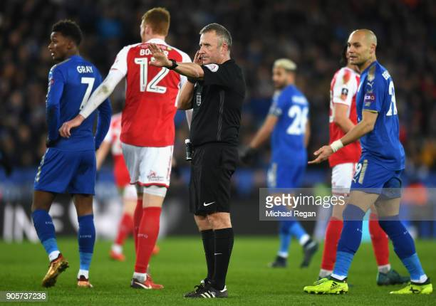 Referee Jon Moss in communication with the video assistant referee during The Emirates FA Cup Third Round Replay match between Leicester City and...