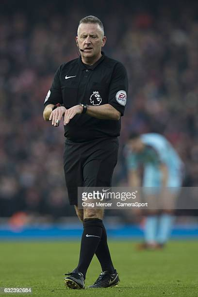 Referee Jon Moss indicates he thought a player was diving during the Premier League match between Arsenal and Burnley at Emirates Stadium on January...