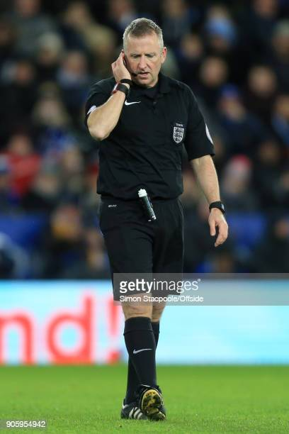 Referee Jon Moss listens to his earpiece during The Emirates FA Cup Third Round Replay match between Leicester City and Fleetwood Town at the King...