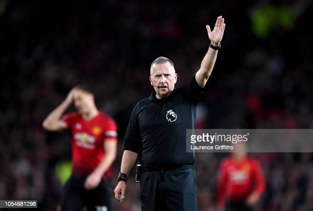 Referee Jon Moss signals during the Premier League match between Manchester United and Everton FC at Old Trafford on October 28 2018 in Manchester...