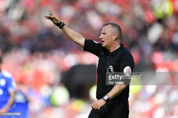 Referee Jon Moss signals during the Premier League match between Manchester United and Cardiff City at Old Trafford on May 12 2019 in Manchester...