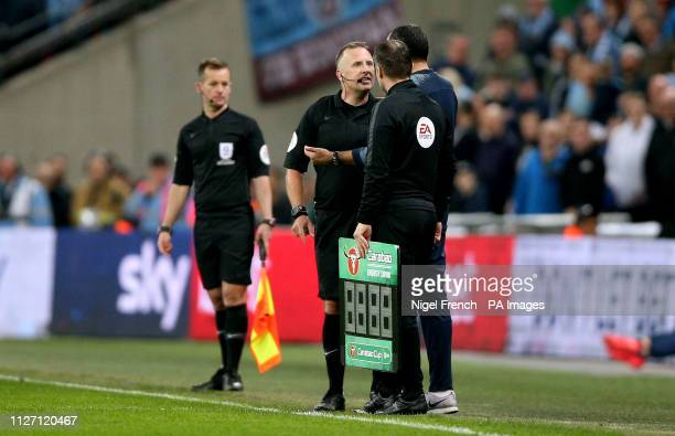 Referee Jon Moss speaks to Chelsea manager Maurizio Sarri after goalkeeper Kepa Arrizabalaga refuses to be substituted during the Carabao Cup Final...