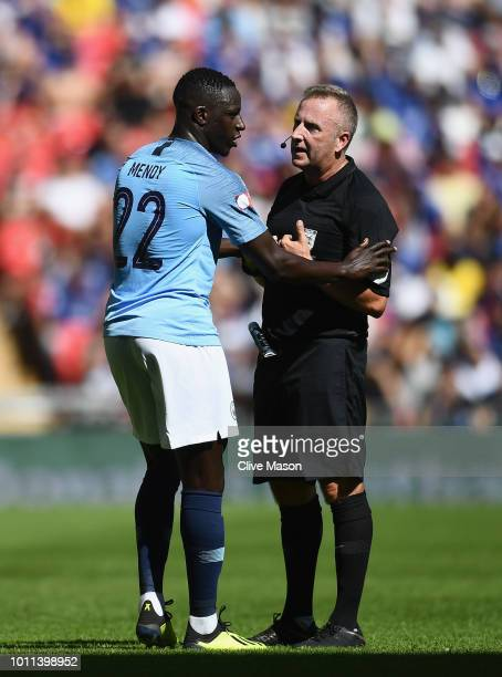 Referee Jon Moss talks to Benjamin Mendy of Manchester City during the FA Community Shield between Manchester City and Chelsea at Wembley Stadium on...