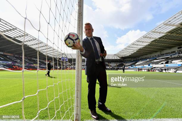Referee Jon Moss tests the goal line technology prior to the Premier League match between Swansea City and Manchester United at Liberty Stadium on...