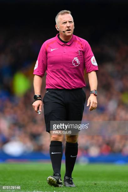 Referee Jon Moss walks during the English Premier League football match between Everton and Chelsea at Goodison Park in Liverpool north west England...