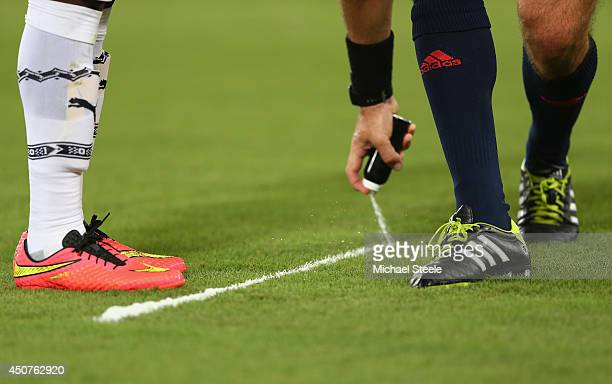 Referee Jonas Eriksson of Sweden sprays foam to mark the free kick distance during the 2014 FIFA World Cup Brazil Group G match between Ghana and the...