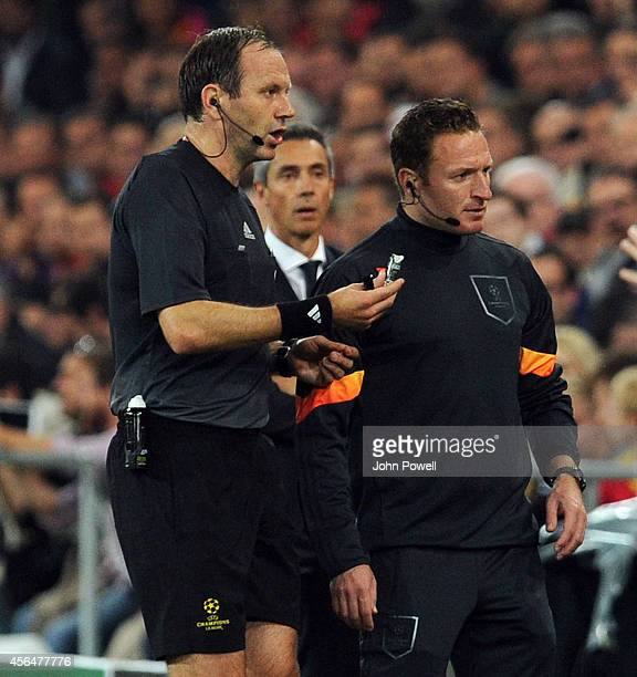 Referee Jonas Eriksson pauses the game during the UEFA Champions League match between FC Basel 1893 and Liverpool FC on October 1 2014 in Basel...