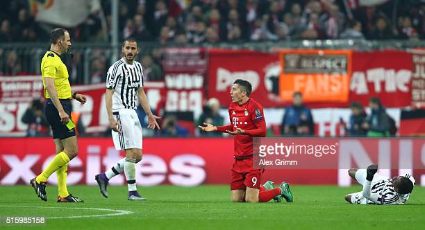 Referee Jonas Eriksson prepares for an yellow card after Robert Lewandowski of Bayern Muenchen and Patrice Evra of Juventus collided during the UEFA...