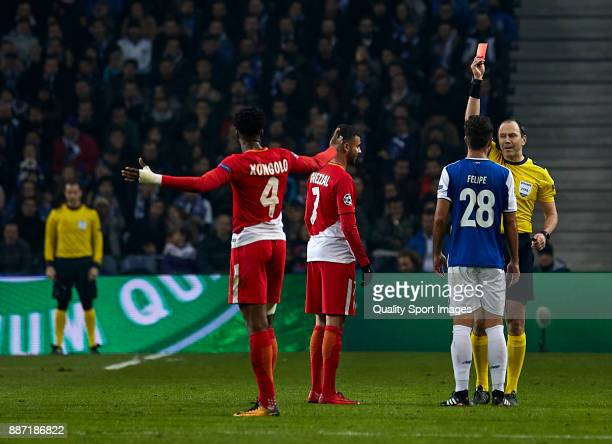 Referee Jonas Eriksson shows red card to Rachid Ghezzal of AS Monaco and Felipe Augusto de Almeida of FC Porto during the UEFA Champions League group...