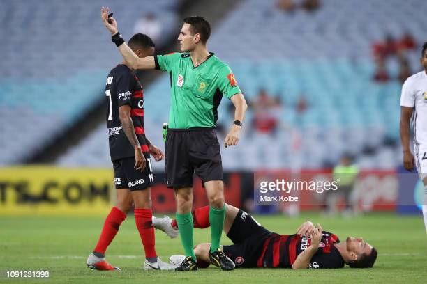 Referee Jonathan Barreiro calls for the trainer as Alex Baumjohann of the Wanderers lies injured on the ground during the round 12 ALeague match...