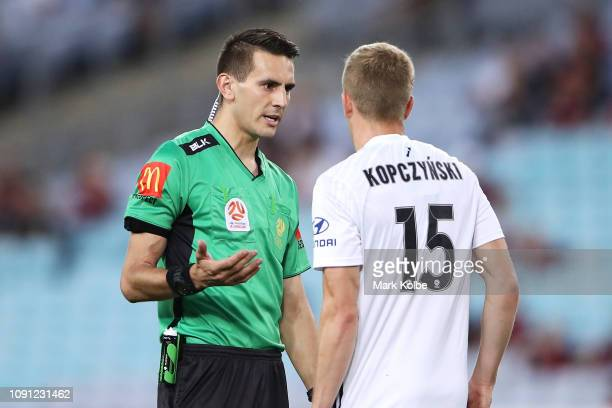 Referee Jonathan Barreiro speaks to Michal Kopzcynski of the Phoenix during the round 12 ALeague match between the Western Sydney Wanderers and the...