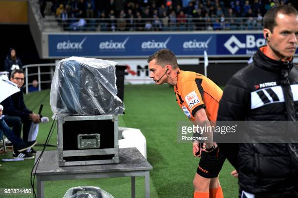 referee Jonathan Lardot asked VAR during the Jupiler Pro League PlayOff 1 match between Kaa Gent and Standard of Liege at Ghelamco stadium on April...