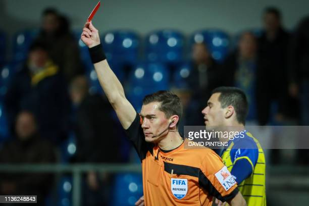 referee Jonathan Lardot gives a red card to WaaslandBeveren's Maximiliano Caufriez during a soccer match between WaaslandBeveren and KV Kortrijk...