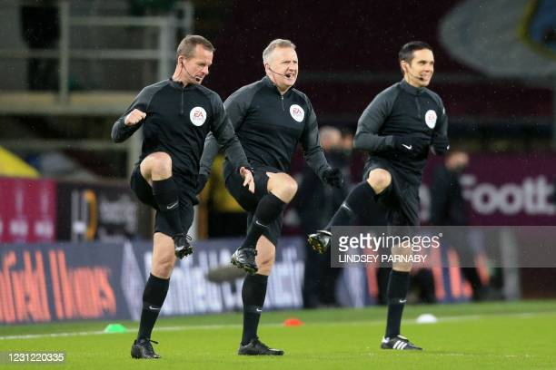 Referee Jonathan Moss and assistants warm up ahead of the English Premier League football match between Burnley and Fulham at Turf Moor in Burnley,...