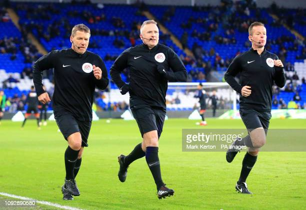 Referee Jonathan Moss and his two assistants warm up ahead of the match during the Premier League match at the Cardiff City Stadium