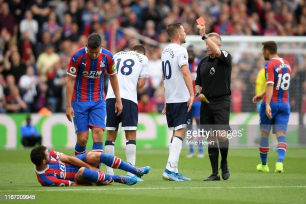 Referee Jonathan Moss awards Morgan Schneiderlin of Everton a red card during the Premier League match between Crystal Palace and Everton FC at...