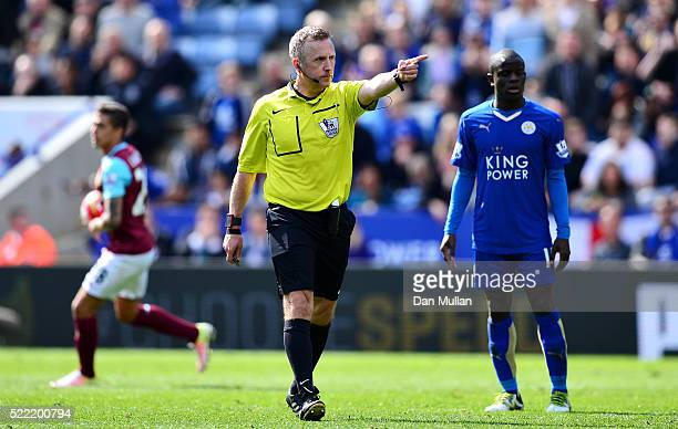Referee Jonathan Moss awards West Ham United a penalty during the Barclays Premier League match between Leicester City and West Ham United at The...