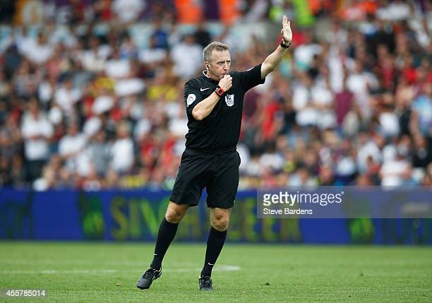 Referee Jonathan Moss blows his whistle during the Barclays Premier League match between Swansea City and Southampton at Liberty Stadium on September...