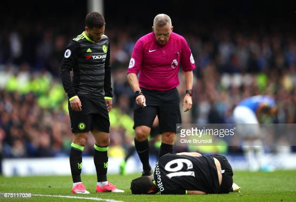 Referee Jonathan Moss checks if Diego Costa of Chelsea is okay after being fouled during the Premier League match between Everton and Chelsea at...