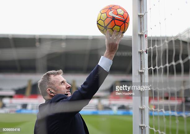 Referee Jonathan Moss checks the goalline technology prior to the Barclays Premier League match between Swansea City and Southampton at Liberty...